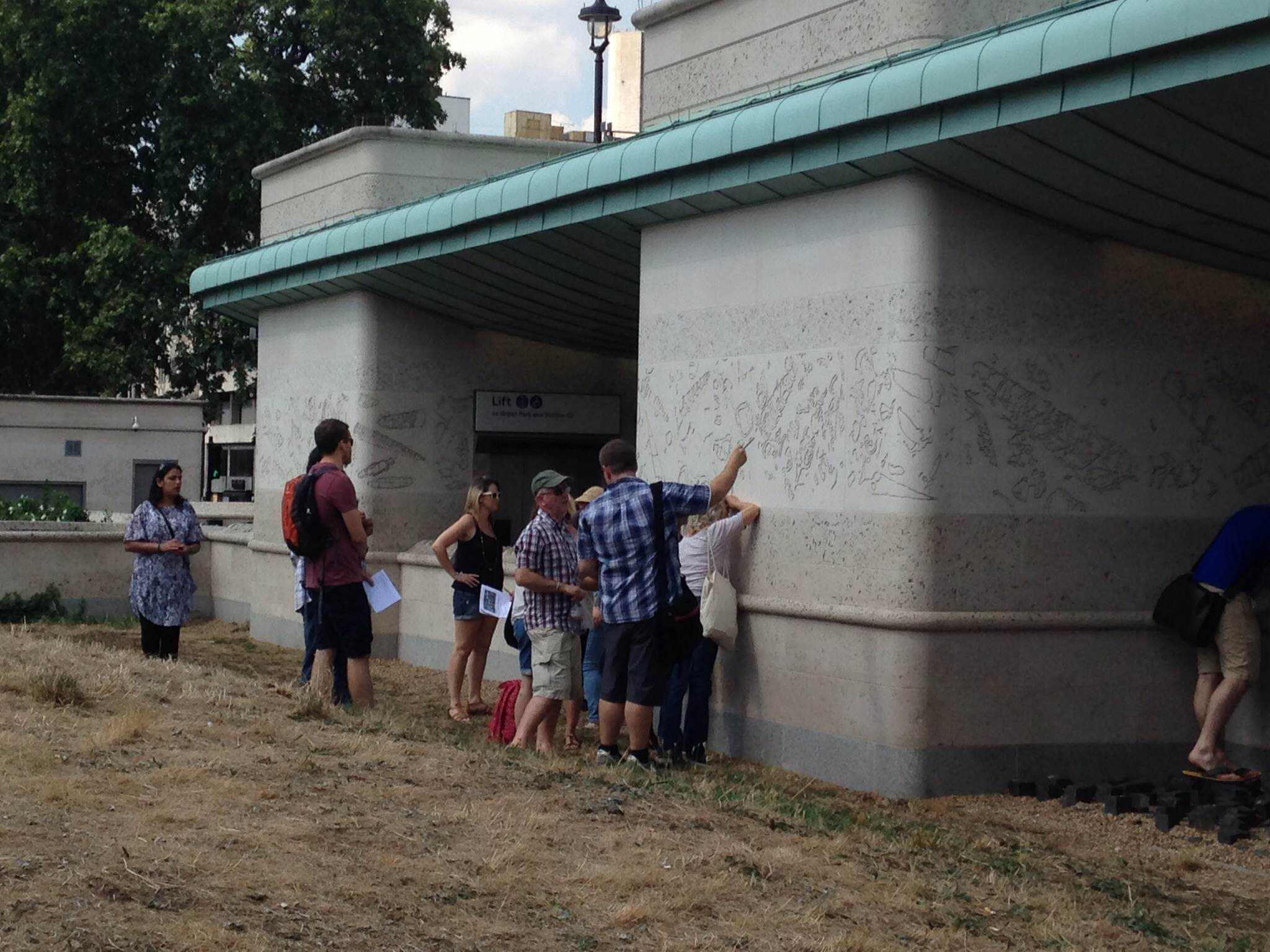 Teachers looking at the Roach from Portland used to construct Green Park Tube Station.
