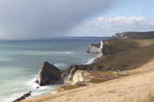 Connecting with the Coast. Storm clouds gathering over Purbeck, one of the most spectacular stretches of the Jurassic Coast.