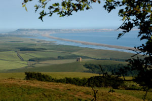 The view across Abbotsbury to Chesil Beach beyond