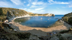Lulworth Cove , a beautiful secluded cove whose existence is owed to the collision of continents and the birth of the Alps