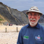 Stuart Godman Fossil Warden on Charmouth Beach