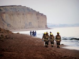 Police, coastguards, the fire service and the local authorities attending the fall. Photograph: Rory Fisher