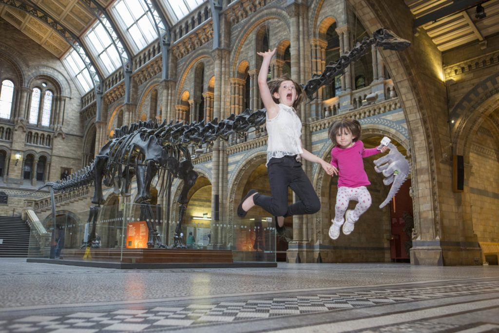 The Diplodocus exhibit with children at the Natural History Museum, London.