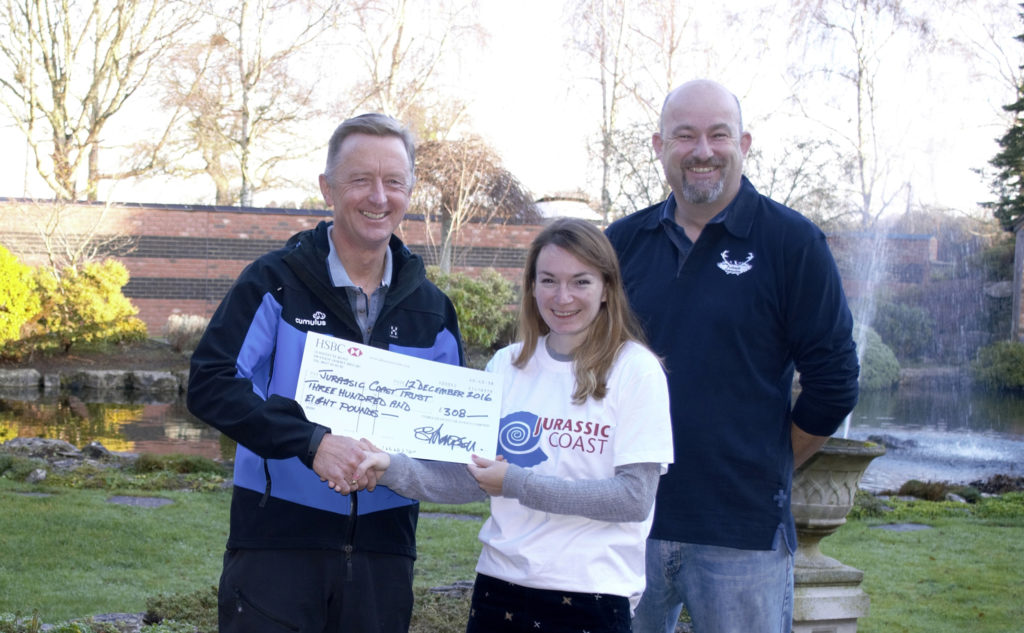 Cheque presentation from Steve Thompson of Cumulus Outdoors to Katie Thomson of the Jurassic Coast Team with Julian Sawyer of Purbeck Footprints.