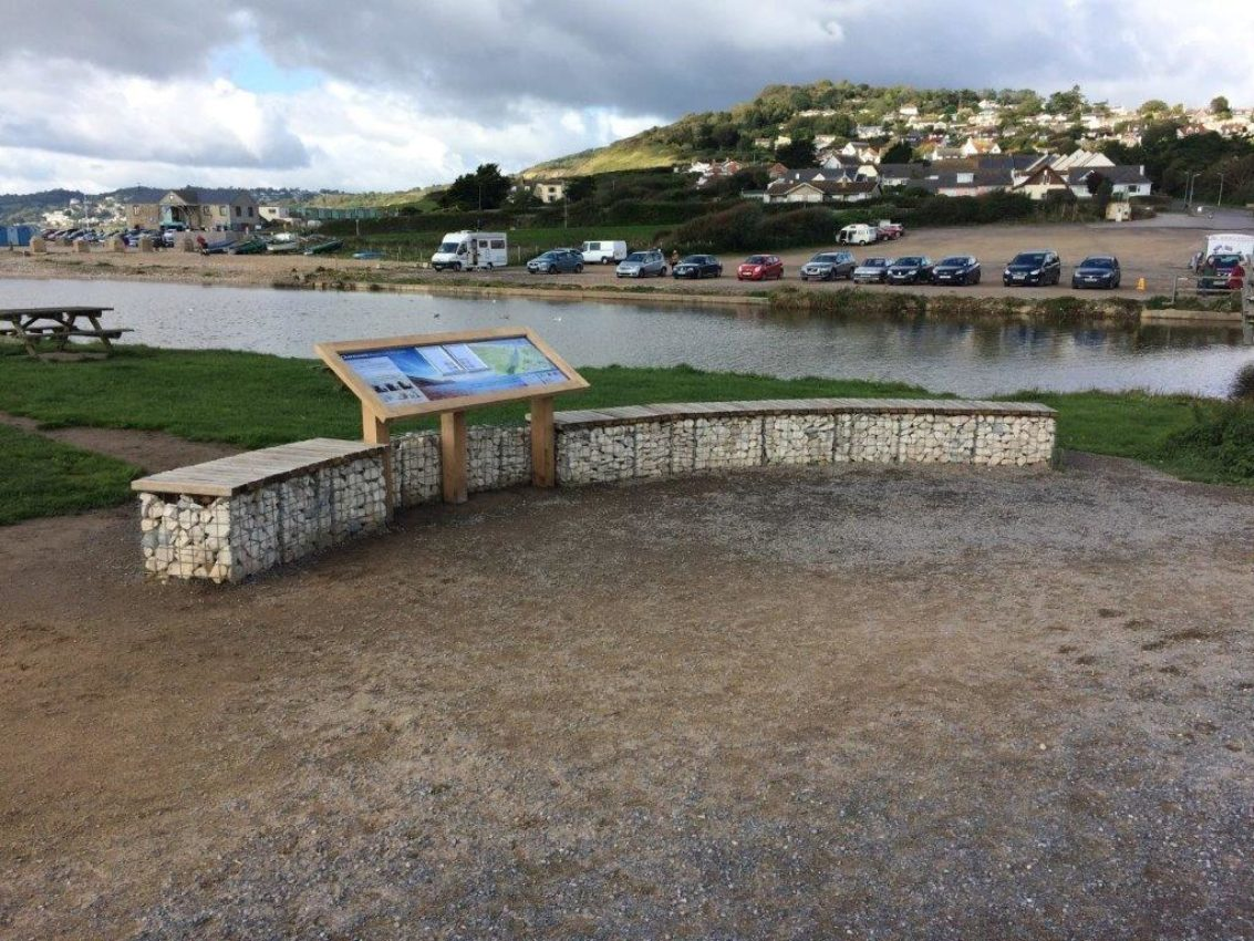 The area east of the bridge at Charmouth, known as Evan's Cliff, has recently been given a makeover with new seating structure and information panel