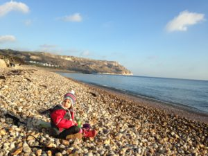 Enjoying a picnic at Ringstead Beach with Sarita who is now 2 years old