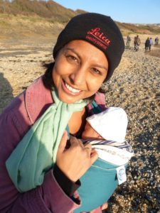 At Ringstead Bay (using a Moby baby wrap) for a walk with my 4 week old baby daughter.