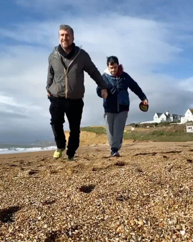 """My Jurassic Coast and the Bond of Brotherhood by @emmanuelcoe.   """"Finding myself in lockdown with my learning disabled brother has been one of the greatest challanges of my life. He has been struggling with his mental health. Some days seem grey and endless. Other days feel warmed by hope.   Living so close to Hive Beach, we often take a walk along the sand to breath the sea air and witness the dances of spectacular light. Reuben often asks me, """"Brother, will this make me good sleep?"""" I reply that it will give him an amazing sleep.   We stroll and ponder the here and now, looking to the horizon in the hope for the future. Right now, most of us can only enjoy today as we have all learn that life is, in its very least, unpredictable. A walk on the beach settles our minds and strengthens us for the time ahead.   As I write this, Reuben is fast asleep upstairs, hopefully dreaming of the sea, with the soft, sucking noise of waves slipping back down the beach calming his mind.""""  #myjurassiccoast"""