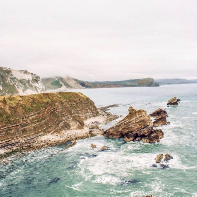 """My Jurassic Coast by @nwaigee   """"The Jurassic Coast is one of my favourite coastlines to explore in the UK. I absolutely love it, and being a geologist I find the history of this place fascinating.""""  #myjurassiccoast  Nwai visited Mupe Bay and the Fossil Forest, third photo courtesy of @benosbornephotography"""