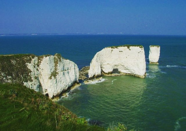 """My Jurassic Coast by our new team member Lauren.  """"At the moment, my favourite place along the  Jurassic Coast is Old Harry Rocks because I adore the tranquility of going to Studland Bay early in the morning and running up from there across the grass fields where you get spectacular panoramic views for miles. With the imposing old Harry Rocks as the focus, it makes running up hill to get there worth it!   I'm really looking forward to exploring more of the Jurassic Coast in the near future.""""  We are all looking forward to working with Lauren as she creates digital content around our wonderful earth science.   #myjurassiccoast"""