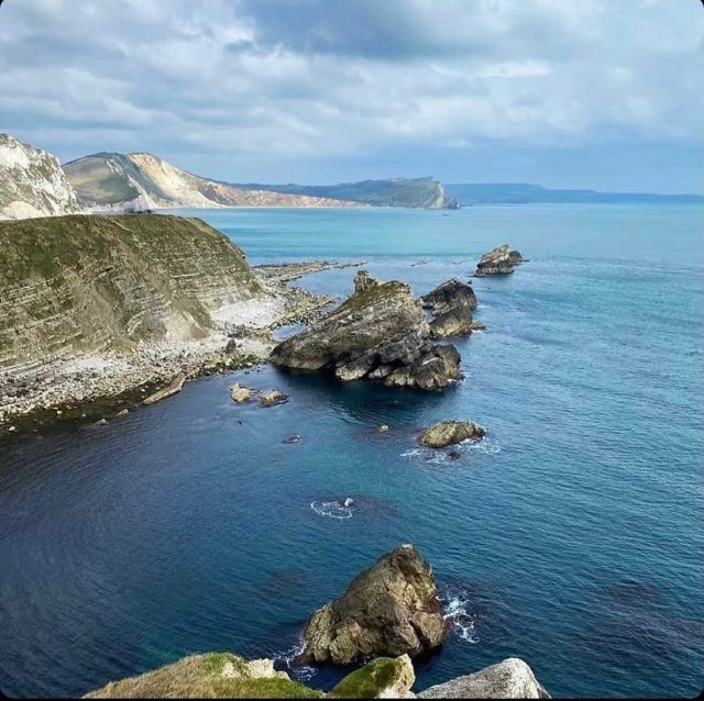 """My Jurassic Coast by @where.terri.wanders.  """"I'm making it my mission to explore all of the Jurassic Coast, it's so varied and there's so much beauty and history at every turn!   I love finding quiet spots, I think my favourite hidden gem is Mupe Bay (miles from any car parks!).   Heading East from the main bay takes you to an even quieter spot - The Smugglers Cave. It's a bit of a scramble over rocks to get to it, but worth the views and tranquility once you get there! You can even see where contraband was once stashed away before movement inland, I love how much you can learn by exploring.  #myjurassiccoast   For walk information you can find out about routes on the South West Coast Path website."""
